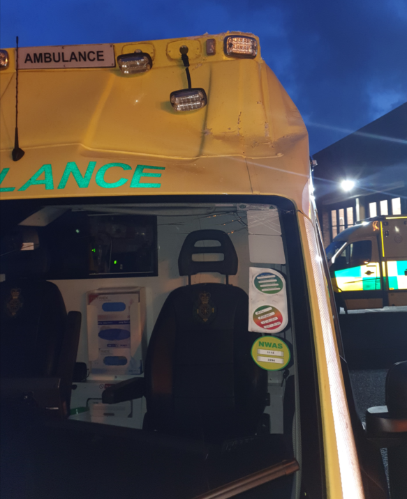 Extensive damage to the cab and emergency lights of an ambulance