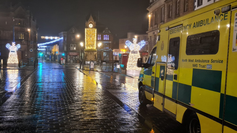 Ambulance in town with Christmas lights