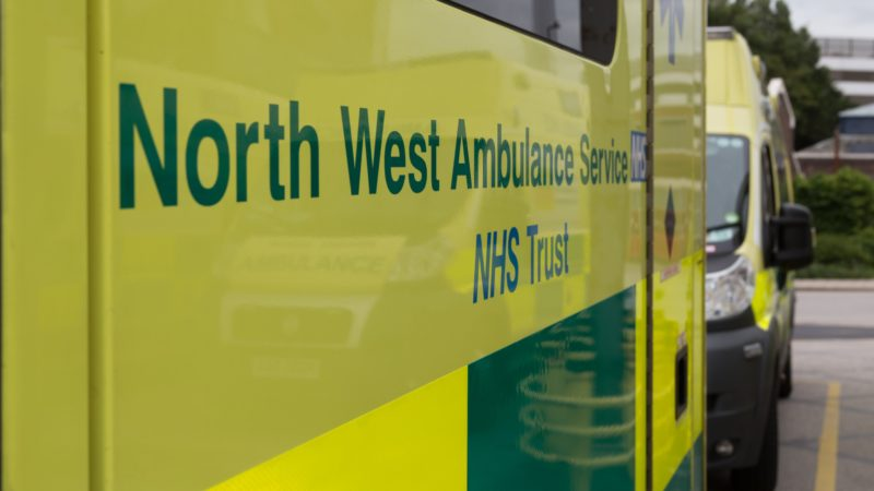 Side of an ambulance reading North West Ambulance Service NHS Trust