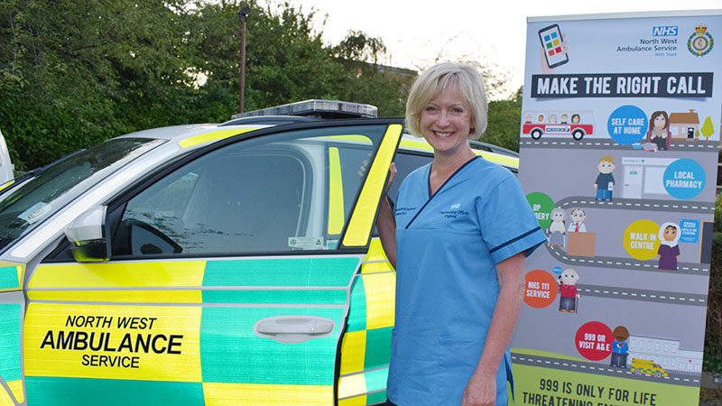 Dr Ruth May outside of rapid response vehicle